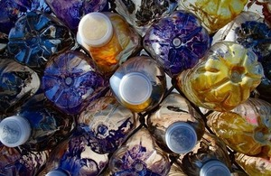 Plastic water bottles stacked together via Wesley Tarwater at Shutterstock