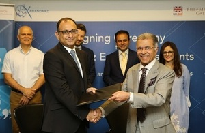The signing of two new equity investment deals between CEO Karandaaz Pakistan, Ali Sarfraz and the owner of Equity Investments.