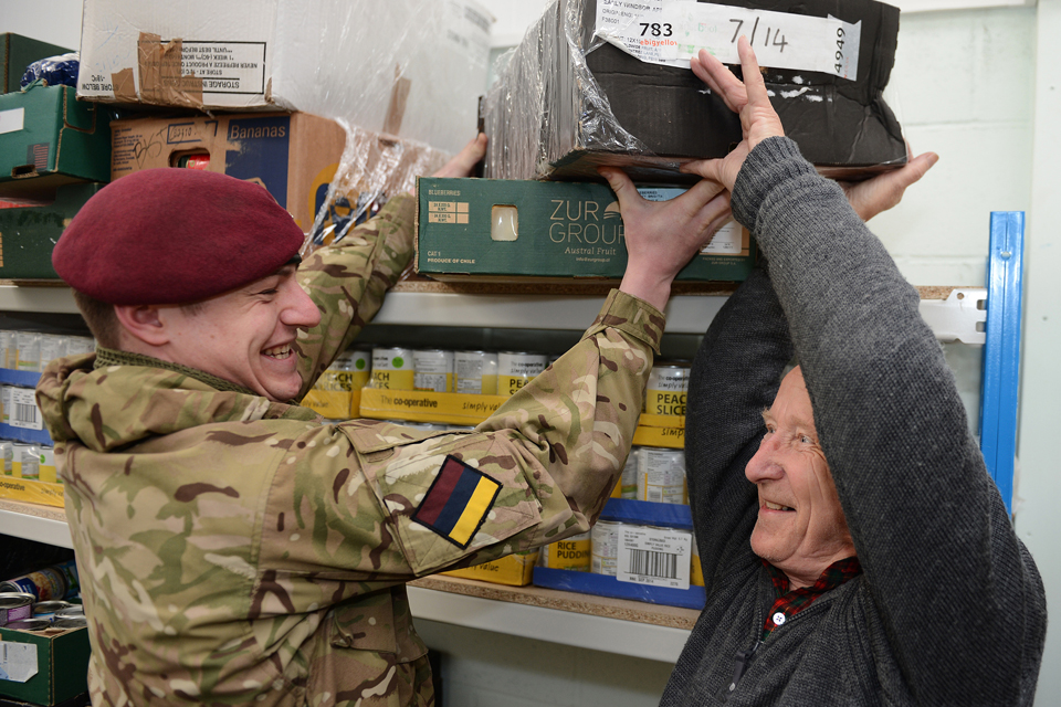 A member of 16 Medical Regiment helps move the Colchester Foodbank to its new premises