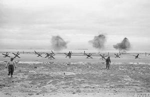 Royal Navy personnel from an obstacle clearance unit blowing up German beach obstacles at La Riviere, Normandy, 9 June 1944.