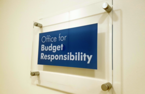 Glass sign on a white wall which reads: Office for Budget Responsibility