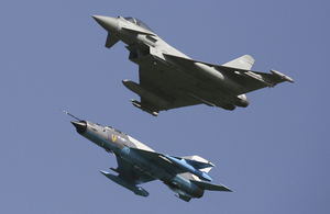 n RAF Typhoon and a Romanian MiG 21 LanceR fly together over MK Airbase in Romania.
