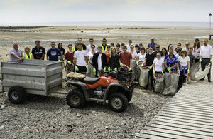 Volunteers picking up litter on Seascale beach.