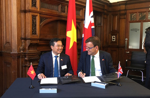 Picture of Greg Hands and Vice-Minister Vuong Hoang Quoc.