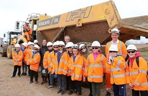 Image shows group of school children visiting the scheme