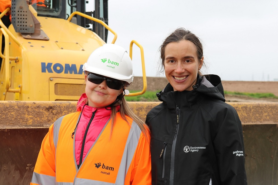 Image shows one of the school children visiting the scheme together with Environment Agency staff member Sarah Pearce
