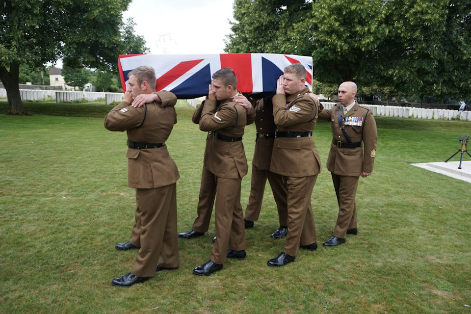 Members of the RTR provide a bearer party for their fallen comrade. Crown Copyright. All rights reserved