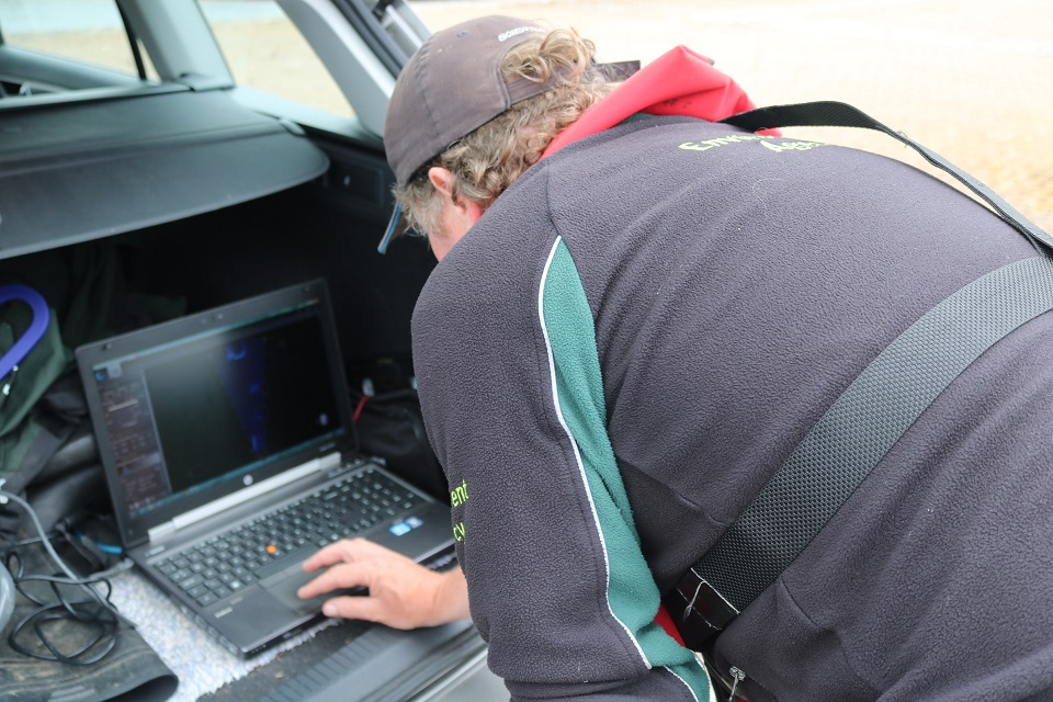 Image of Phil Rippon checking the sonar footage