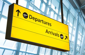 Airport departures and arrivals sign.