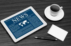News tablet and coffee mug