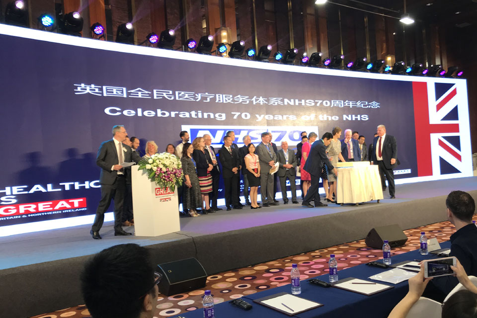 Picture of congress platform with participants celebrating the UK's National Health Service's 70th birthday