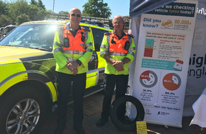 Traffic officers Julian Morant and Adrian Smith alongside the Highways England stand at the towing and tyre safety event at Gordano Services