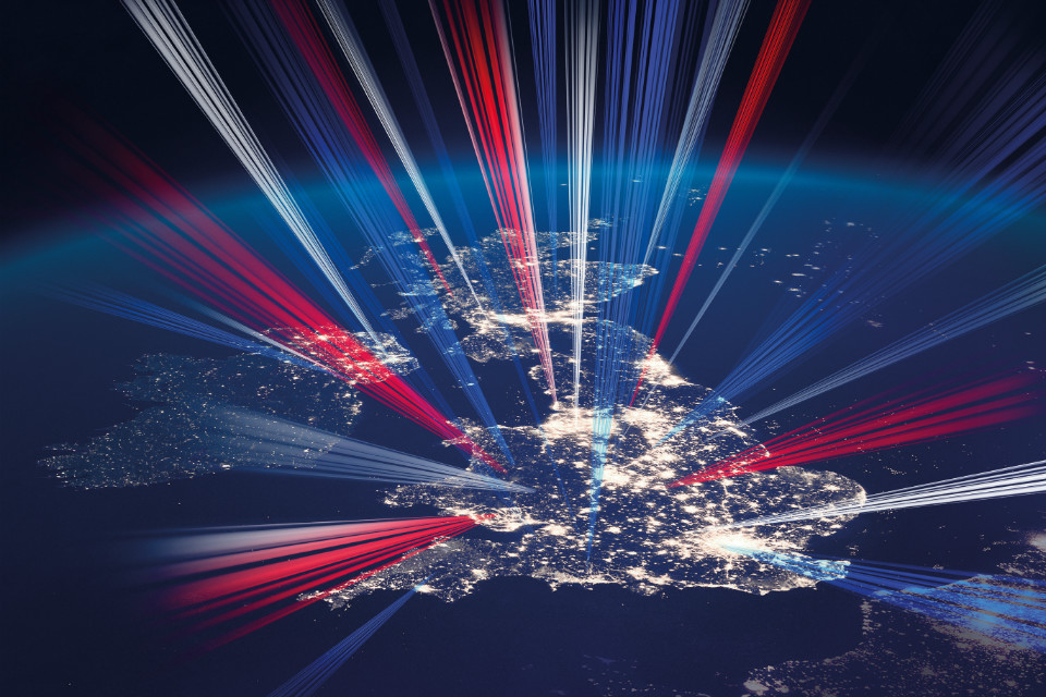 Illustration of the UK at night with red, white and blue lasers (detail of the Industrial Strategy front cover)