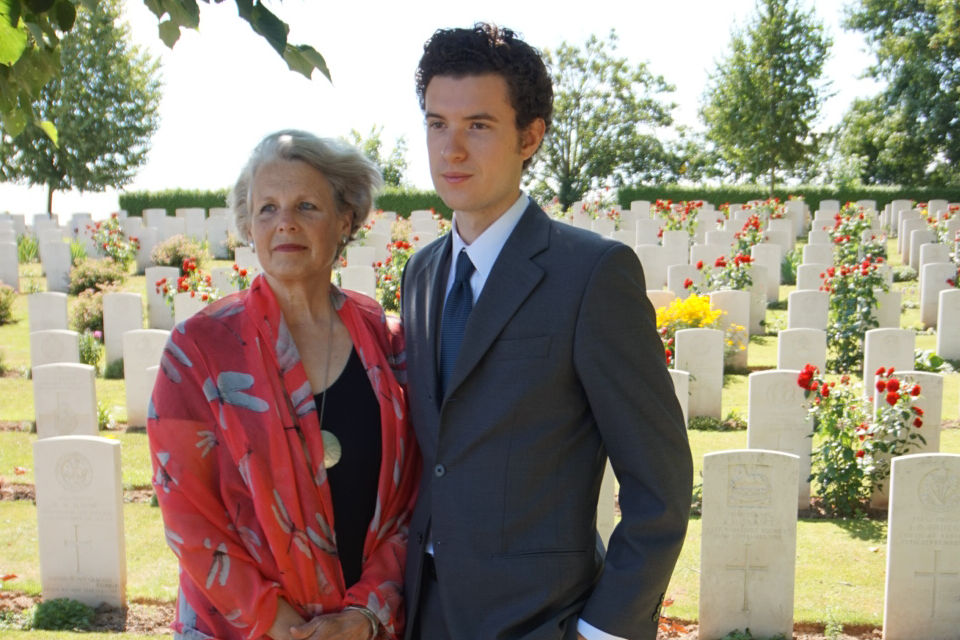 Great nephew Sebastien Molgart with his mother Liane Benoit at the graveside of Pilot Officer McCann. Crown Copyright. All rights reserved.