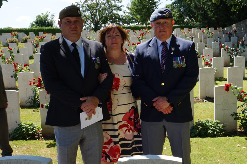 Great niece Terri Griffin with two members of the family behind the headstone of Sergeant Watson. Crown Copyright. All rights reserved.