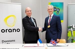 NDA CEO David Peattie signing the Roadmap of Collaboration with Guillaume Dureau, of Orano SEVP