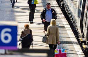 Passengers on a rail platform.