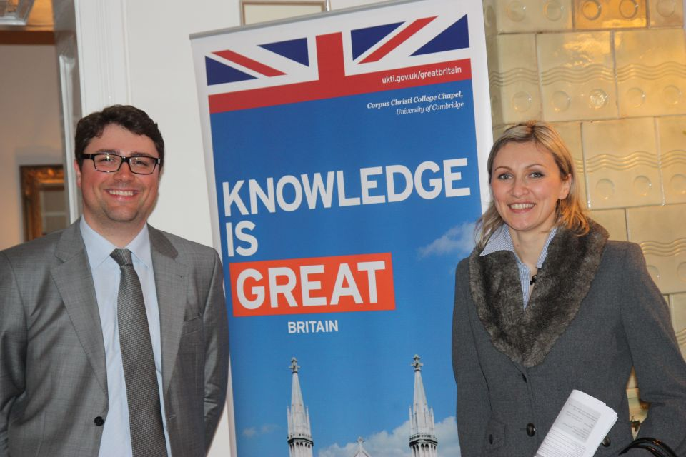 "UKTI Trade Advisor with Ms Marija Vujica from the Agency for education and translations ""Libar"" standing in front of the Knowledge is GREAT banner."