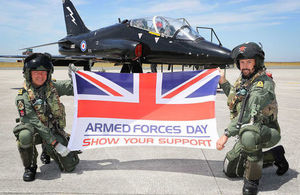 Hawk pilots Lt Nick Weightman (L) and Lt Tom Sawle show their support for Armed Forces Day 2018 at RNAS Culdrose.