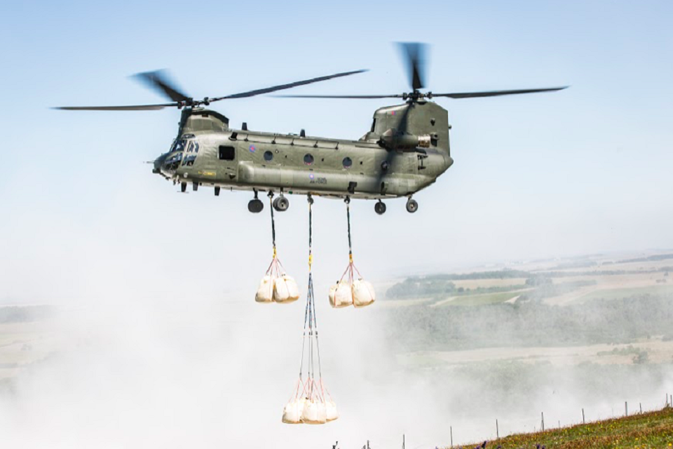 A Chinook delivers bags of chalk to re-chalk the kiwi for the first time in 30 years.