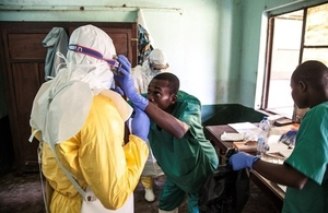 Ebola health workers get ready to visit suspected Ebola patients in the DRC. Credit: Unicef