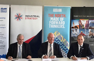 Lord Henley, Councillor Ray Oxby, and Jake Berry signing the Greater Grimsby Town Deal.