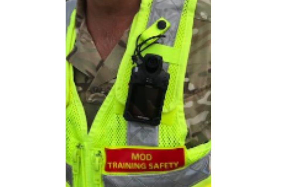 New hi-vis vest and body camera aimed at identifying repeat offenders. Crown Copyright, MOD 2018.