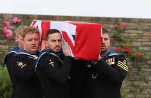 Members of the Royal Navy, who provided the bearer party and firing party, take AB Robertson to his final resting place, Crown Copyright, All rights reserved