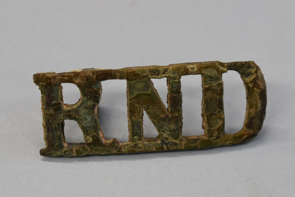Royal Naval Division shoulder title that was discovered in one of AB Robertson's pockets, Copyright Commonwealth War Graves Commission, All rights reserved