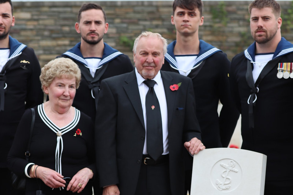 Nephew Frank Treasurer standing with his wife and members of the Royal Navy beside the grave of AB Robertson, Crown Copyright, All rights reserved