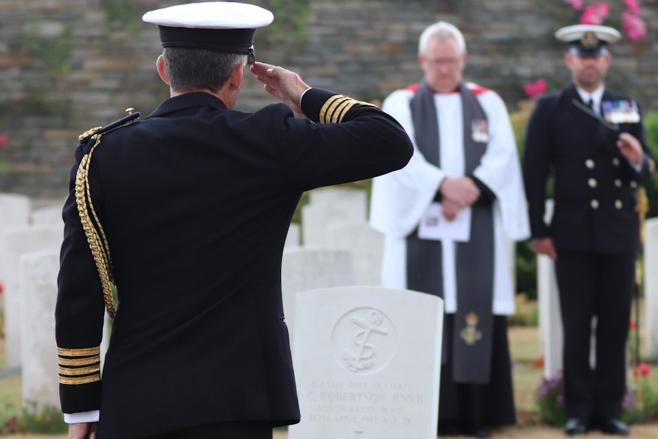 Captain Keri Harris, Naval Attaché to France raises a salute in honour of AB Robertson, Crown Copyright, All rights reserved