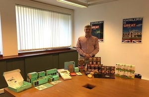 Picture of David Hill, Managing Director at Cocoda in front of a selection of Cocoda products.