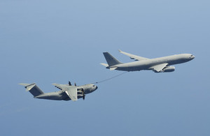 Atlas transport aircraft refuelling during its flight across the Atlantic sea.
