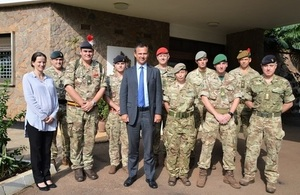 Armed Forces Minister Mark Lancaster in Uganda, flanked by troops who are providing training for the African Union's Mission in Somalia.