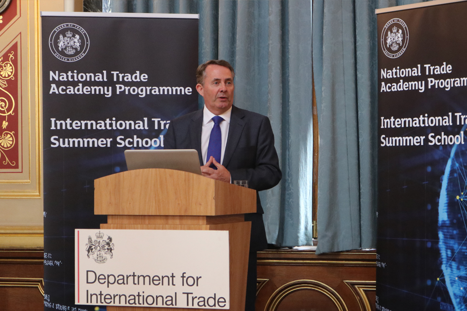 International Trade Secretary Dr Liam Fox speaking at a lectern.