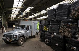 baled waste found in a farm warehouse