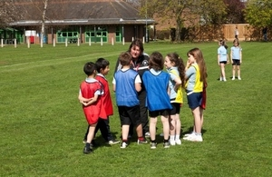 Primary school children doing PE outside
