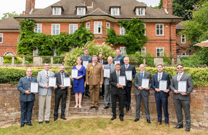 Members of the JFC staff pose for a photo with General Sir Chris Deverell, after recieving their commendations