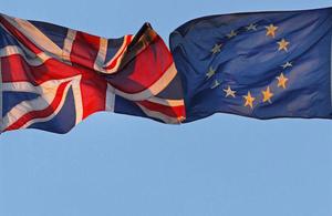 Image of British and EU flags.