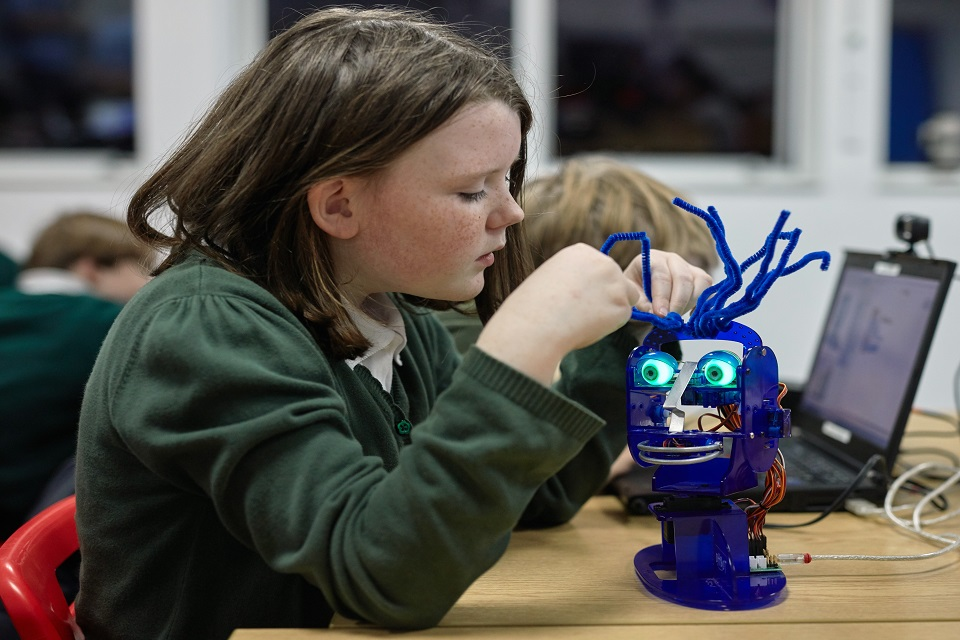 Image of child using the Ohbot robot.