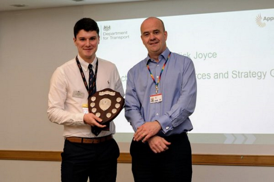 Image of Tom Parkin collecting the DfT Apprentice of the Year award
