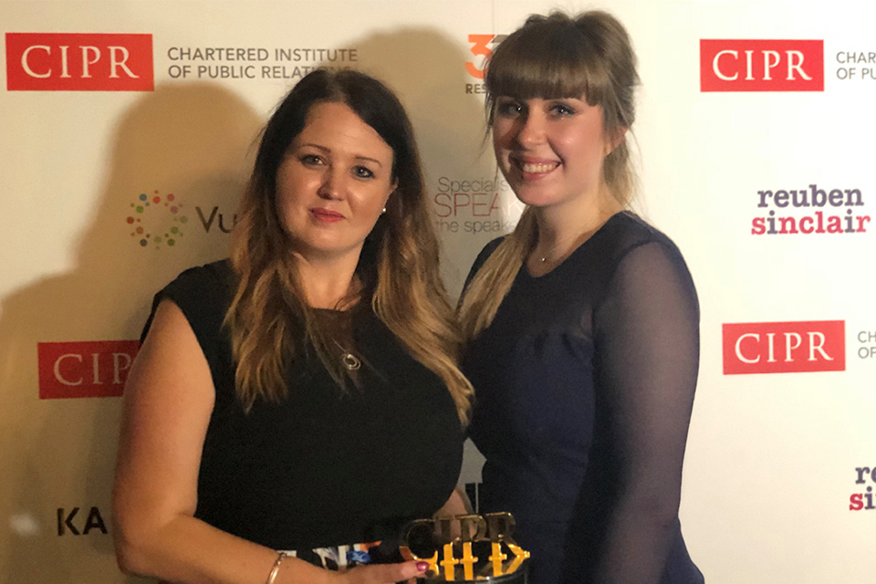 Image of Abigail Britten and Olivia Roe collecting the CIPR Excellence Award