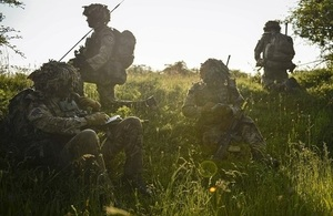 Four soldiers sitting in the grass