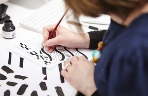 Picture of founder Alison Hardcastle designing a happy birthday card.