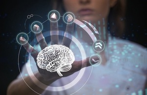 A doctor manipulates a digital model of a brain