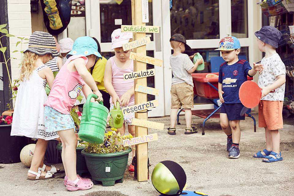 A group of children playing at the nursery.