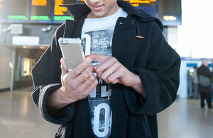 Picture of person with mobile phone.