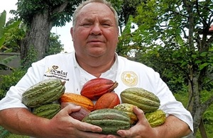 Picture of David Greenwood Haigh holding cacao fruit.