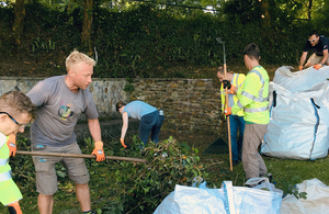image of volunteers clearing vegetation