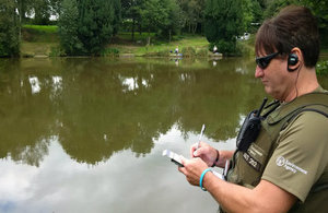 Environment Agency officers checking fishing licences